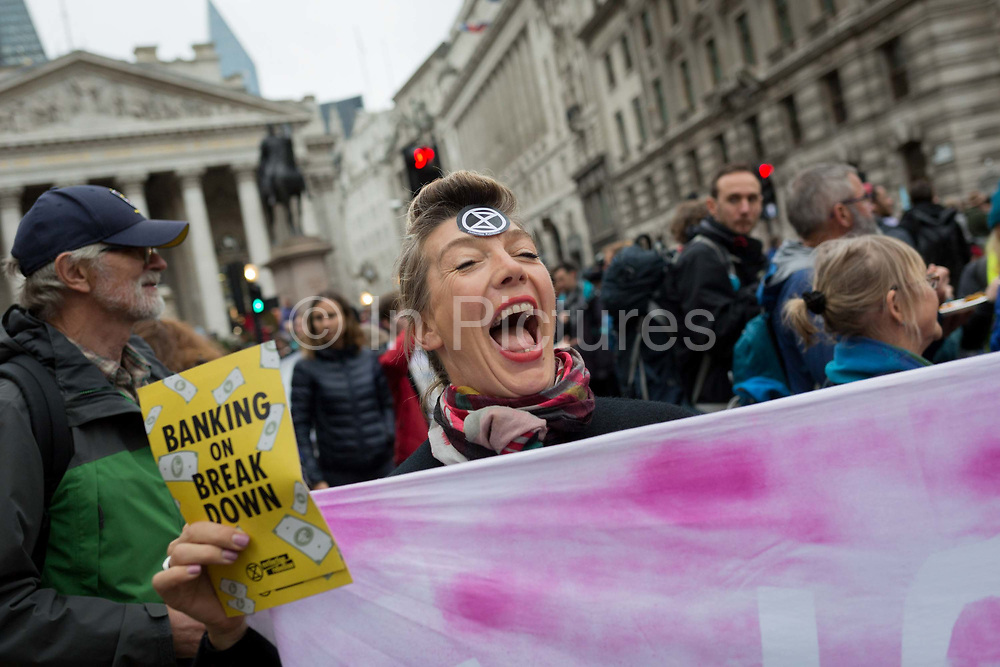 Environmental activists protest about Climate Change during the blockade at the junction at Bank in the heart of the capitals financial district, the City of London aka the Square Mile, on the seventh day of a two-week prolonged worldwide protest by members of Extinction Rebellion, on 14th October 2019, in London, England.