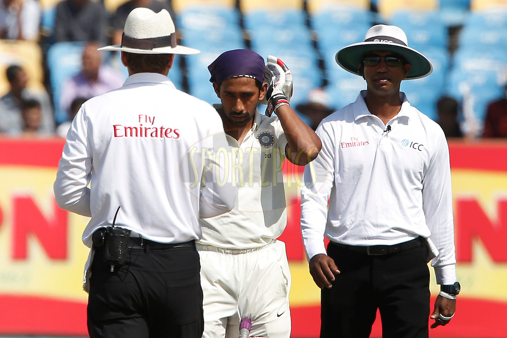 Wriddhiman Saha of India hit with ball during day 4 of the first test match between India and England held at the Saurashtra Cricket Association Stadium , Rajkot on the 12th November 2016.<br /> <br /> Photo by: Deepak Malik/ BCCI/ SPORTZPICS