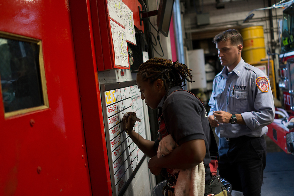 Firefighter Melissa Bennett fills out a board at the quarters of Engine 257, 1361 Rockaway Parkway, Brooklyn, NY on Tuesday, Oct. 6, 2015.<br /> <br /> Andrew Hinderaker for The Wall Street Journal<br /> NYFDNY