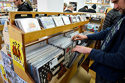 © Licensed to London News Pictures. 13/04/2019. LONDON, UK. Customers brows in Sounds of the Universe records shop. Analogue music fans visit independent record shops in Soho to celebrate vinyl music on the 12th Record Store Day.  Over 200 independent record shops across the UK come together annually to celebrate the unique culture of analogue music with special vinyl releases made exclusively for the day.  In 2018, sales of vinyl rose for the 11th consecutive year to 4.2 million units according to the British Phonographic Industry (BPI).  Photo credit: Stephen Chung/LNP