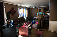 Victoria Ardoin inside the DeBate's home helping the family gather some things after the flood waters in Denham Springs Louisiana started to go down.