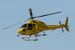 April 27, 2018 - Richmond, British Columbia, Canada - A Eurocopter AS355 Ecureuil 2 Twinstar helicopter (C-GTLC) belonging to Talon Helicopters Ltd. departs from Vancouver International Airport. (Credit Image: © Bayne Stanley via ZUMA Wire)