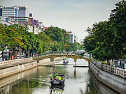 09 SEPTEMBER 2016 - BANGKOK, THAILAND:  A garbage boat (foreground) and a new passenger boat come down Khlong Phadung Krung Kasem. Trial services have started on a 5-kilometre boat route on Khlong Phadung Krung Kasem between Hua Lamphong and Thewes piers. The service is operated by the Bangkok Metropolitan Administration (BMA). The city is using converted garbage boats, fitted with seats, awnings and life preservers. If the trial run is successful regular passenger boats will be put on the route.      PHOTO BY JACK KURTZ