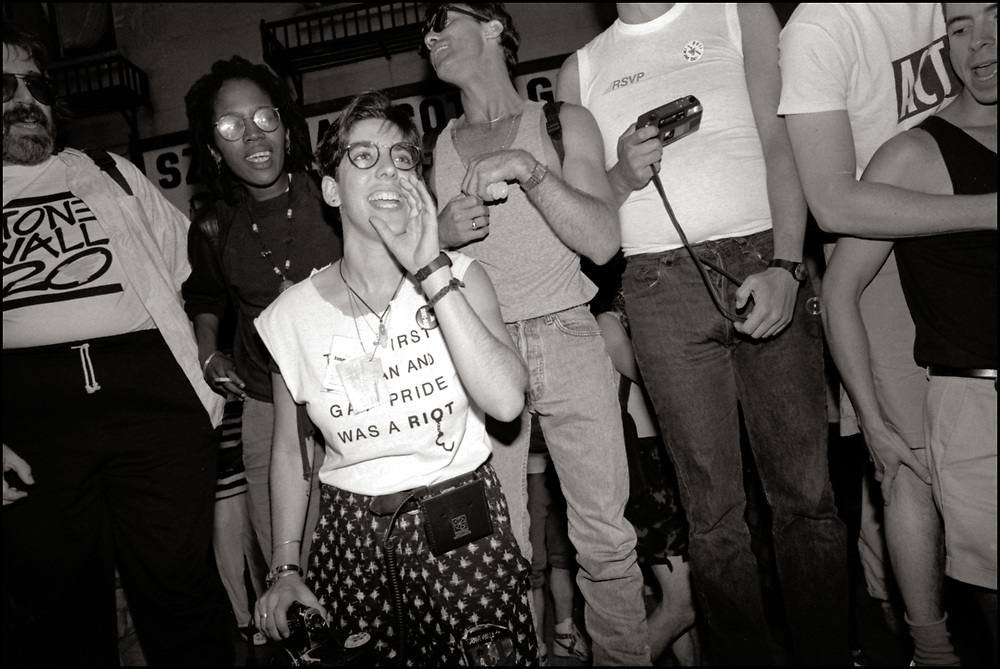 """Ellen Neipris, Joan Gibbs and Peter Staley of ACT UP NY, on June 24, 1989, the 20th anniversary of the Stonewall riots, participating in a renegade march up 6th avenue to Central Park. Themed, """"In The Tradition"""", this march followed the same route as the original march 20 years ago and was designed as a rebuke to the corporatization of the gay pride parade."""