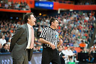 29 MAR 2015: Coach Rick Pitino of the University of Louisville yells to his players against Michigan State University during the 2015 NCAA Men's Basketball Tournament held at the Carrier Dome in Syracuse, NY. Michigan State defeated Louisville 76-70 to advance. Brett Wilhelm/NCAA Photos
