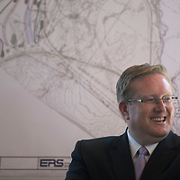 Tommy Haws, president of Greater Gallup Economic Development Corporation, sits in front of a map for the Gallup Energy Logistics Park at a groundbreaking ceremony held at the Cultural Center in Gallup Monday.