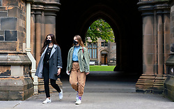 Glasgow, Scotland, UK. 25 September, 2020. Many students at Glasgow University have tested positive for the Covid-19 virus. The Scottish Government has controversially ordered students in several halls of residence where positive cases have spiked, to self-isolate indefinitely. Pictured; Students wearing facemasks in University cloisters.  Iain Masterton/Alamy Live News