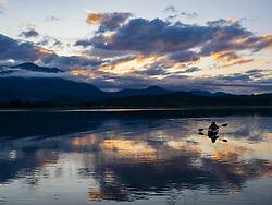 United States, Washington, Quilcene, kayaker in bay at sunset