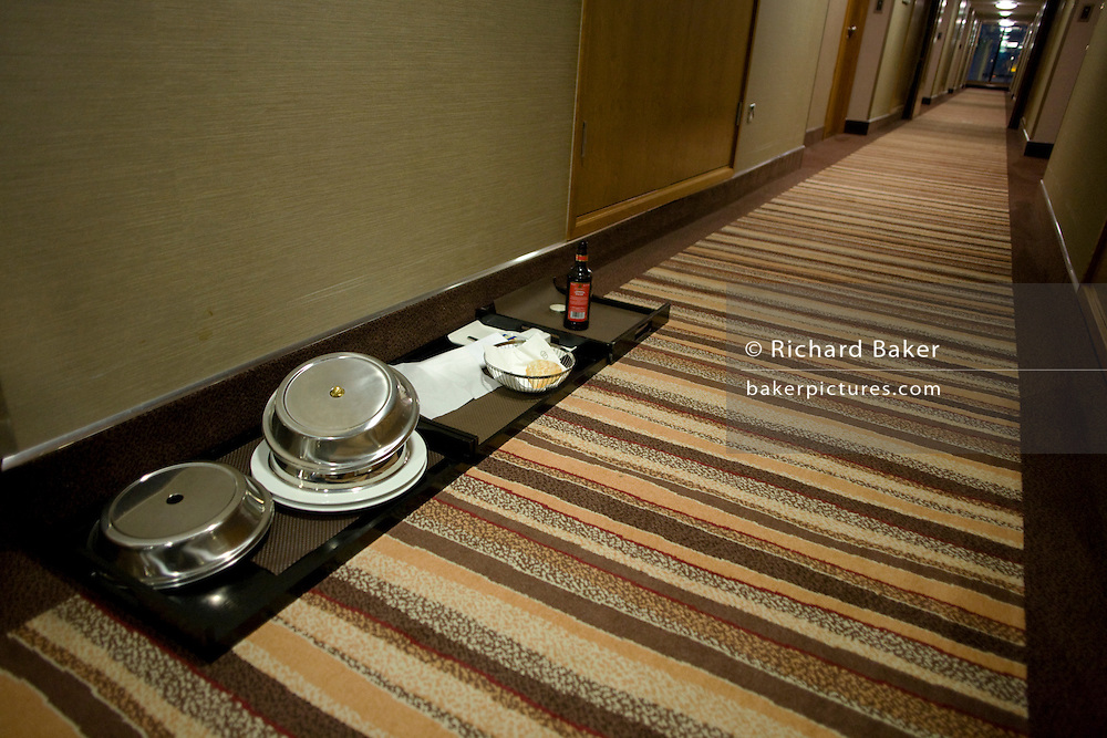 Room service plates and dishes on a floor of the 605 room Sofitel hotel chain at Heathrow Airport's T5.