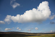 Littondale is a Yorkshire Dale in the Craven district of North Yorkshire, England, UK. Known for it's smooth rolling hills and traditional farmhouses that date from the 17th century. Beautiful cloud formation in a blue sky.