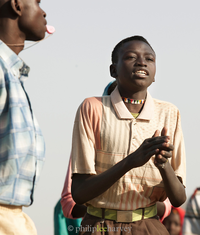 A child of the Nuba tribe taking partin a welcome dance at the school in Nyaro village, Kordofan region, Sudan