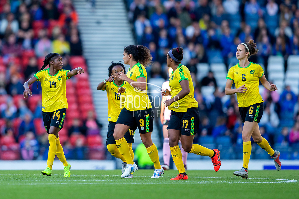 Den-Den Blackwood (#14) of Jamaica issues instructions to team mates following Jamaica's first goal (0-1) during the International Friendly match between Scotland Women and Jamaica Women at Hampden Park, Glasgow, United Kingdom on 28 May 2019.