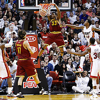 24 January 2012: Cleveland Cavaliers small forward Alonzo Gee (33) dunks the ball past Miami Heat power forward Udonis Haslem (40) during the Miami Heat 92-85 victory over the Cleveland Cavaliers at the AmericanAirlines Arena, Miami, Florida, USA.