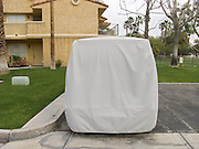 large parked car with cover