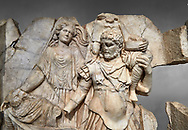 Close up of a Roman Sebasteion relief  sculpture of Aineas' flight from Troy, Aphrodisias Museum, Aphrodisias, Turkey.  Against a grey background.<br /> <br /> Aineas in armour carries his aged farther Anchises on his shoulders and leads his young son Lulus by his hand. They are fleeing from the sack of Troy. The figure floating behind is Aphrodite, Aineas' mother: she is helping their escape. Old Anchises carries a round box that held images of Troy's ancestral gods. .<br /> <br /> If you prefer to buy from our ALAMY STOCK LIBRARY page at https://www.alamy.com/portfolio/paul-williams-funkystock/greco-roman-sculptures.html . Type -    Aphrodisias     - into LOWER SEARCH WITHIN GALLERY box - Refine search by adding a subject, place, background colour, museum etc.<br /> <br /> Visit our ROMAN WORLD PHOTO COLLECTIONS for more photos to download or buy as wall art prints https://funkystock.photoshelter.com/gallery-collection/The-Romans-Art-Artefacts-Antiquities-Historic-Sites-Pictures-Images/C0000r2uLJJo9_s0