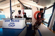 Crew on a bangka boat, Mindoro Island, Philippines, Southeast Asia, 2016