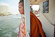 Mar 25, 2009 -- BANGKOK, THAILAND: A Buddhist monk rides on a Chao Phraya River ferry boat along the Bangkok waterfront. The Chao Phraya River is a major transportation artery in Bangkok. Photo by Jack Kurtz