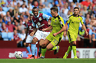 Jordan Ayew of Aston Villa  (l) looks to go past Richie Smallwood of Rotherham Utd. EFL Skybet championship match, Aston Villa v Rotherham Utd at Villa Park in Birmingham, The Midlands on Saturday 13th August 2016.<br /> pic by Andrew Orchard, Andrew Orchard sports photography.