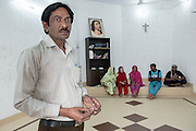 17. Pastor Pervez at the newly renovated Joseph Colony Catholic Church.<br /> These following photographs were taken after the repairs which were partially funded by the government to save face for the May 2013 elections. The Joseph Colony is surviving so far.