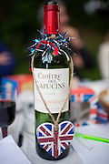 Union Jack flag on wine bottle as patriotic gesture for jubilee street party celebrations in the UK