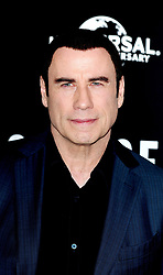 John Travolta attending a photocall for new film Savages at the Mandarin Hotel, London.