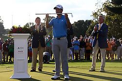 September 24, 2017 - Atlanta, Georgia, United States - Xander Schauffelle holds the Calamity Jane trophy on the 18th green after winning the final round of the TOUR Championship at the East Lake Club. (Credit Image: © Debby Wong via ZUMA Wire)