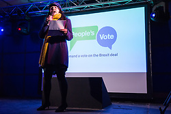 London, UK. 15th January, 2019. Amelia Womack, Deputy Leader of the Green Party, addresses pro-EU activists attending a People's Vote rally in Parliament Square as MPs vote in the House of Commons on Prime Minister Theresa May's proposed final Brexit withdrawal agreement.