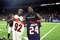 Houston Texans cornerback Johnathan Joseph, left, and Cincinnati Bengals defensive tackle Pat Sims exchange jerseys after an NFL football game Saturday, Dec. 24, 2016, in Houston. The Texans won 12-10. (AP Photo/Sam Craft)