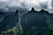Na Pali Coast sea cliffs above Kee Beach seen via helicopter over island of Kauai, Hawaii, USA.