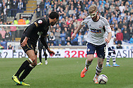 Bolton Wanderer's Tim Ream brings the ball forward. Skybet football league championship match , Bolton Wanderers v Wigan Athletic at the Reebok stadium in Bolton on Saturday 29th March 2014.<br /> pic by David Richards, Andrew Orchard sports photography.