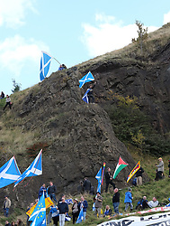 All Under One Banner Independence March, Edinburgh, Saturday 6th October 2018<br /> <br /> Pictured: Flags were being flown from Salisbury Crags<br /> <br /> Alex Todd | Edinburgh Elite media