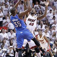 21 June 2012: Oklahoma City Thunder small forward Kevin Durant (35) is blocked by Miami Heat power forward Udonis Haslem (40) during the Miami Heat 121-106 victory over the Oklahoma City Thunder, in Game 5 of the 2012 NBA Finals, at the AmericanAirlinesArena, Miami, Florida, USA. The Miami Heat wins the series 4-1.