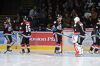 KELOWNA, CANADA, OCTOBER 11: Carter Rigby #11, Spencer Main #16, Colton Heffley #25 and Adam Brown #1 of the Kelowna Rockets take part in a pre-game ritual as the Medicine Hat Tigers visited the Kelowna Rockets on October 11, 2011 at Prospera Place in Kelowna, British Columbia, Canada (Photo by Marissa Baecker/shootthebreeze.ca) *** Local Caption *** Carter Rigby;Spencer Main;Colton Heffley;Adam Brown;