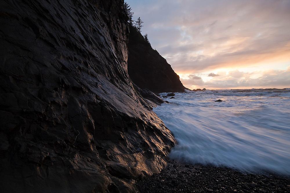Waves cracsh against the high cliffs at First Beach near La Push, Olympic Peninsula, Washington.