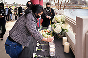 21 MARCH 2021 - DES MOINES, IOWA: A Des Moines woman places incense on the altar memorializing the 8 people murdered in Atlanta last week. Nearly 200 people attended a memorial service at the Robert D. Ray Asian Gardens in Des Moines Sunday for the victims of a gunman who murdered 8 people in Atlanta, GA, on Tuesday, 16 March 2021. The murder victims included six women of Asian descent and ignited awareness of anti-Asian racism across the US.       PHOTO BY JACK KURTZ