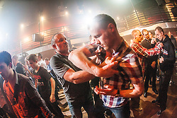 Hand grips with the students. IKMS 'In The Club' seminar with KMG Global Team Instructor and Expert Level 5, Tommy Blom, at the Buff Club in Glasgow's City Centre. Bringing Krav Maga training out with the confines of the gym into a real nightclub/bar.<br /> © Michael Schofield.
