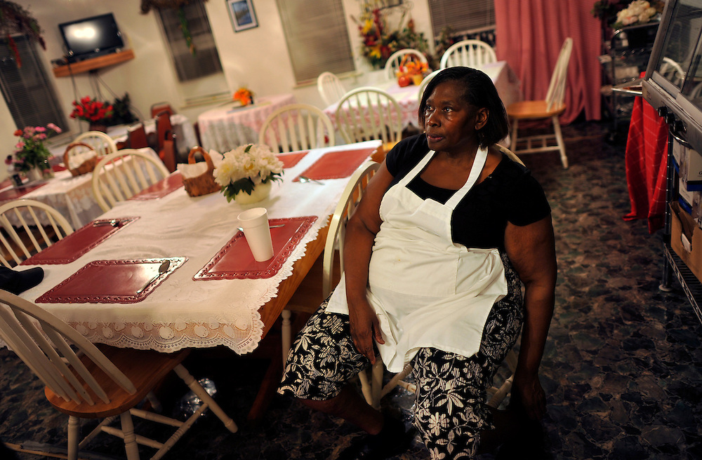 Lula Walker takes a break after serving dinner to customers at her restaurant Lula's Kitchen on Sapelo Island, Georgia. Mrs. Walker is one of several African  Geechee-Gullah residents facing a property tax increase close to 1,000 percents from 2011 county tax assessments. Walker can trace her family's heritage back to slavery before the Civil War. (Stephen Morton for The New York Times)