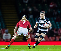 Beth Stafford of Barbarians under pressure from Bethan Lewis of Wales<br /> <br /> Photographer Simon King/Replay Images<br /> <br /> Friendly - Wales v Barbarians - Saturday 30th November 2019 - Principality Stadium - Cardiff<br /> <br /> World Copyright © Replay Images . All rights reserved. info@replayimages.co.uk - http://replayimages.co.uk