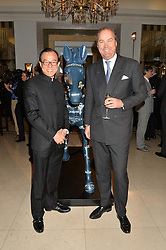 Left to right, Malaysian horse racing tycoon TEO AH KHING and The HON.HARRY HERBERT at the Longines World's Best Racehorse Awards 2014 hosted by Longines and the International Federation of Horseracing Authorities held at Claridge's, Brook Street, London on 20th January 2015.