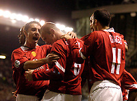 Photo. Jed Wee. Digitalsport<br /> Manchester United v Fenerbahce SK, UEFA Champions League, 28/09/2004.<br /> Manchester United debutant Wayne Rooney is mobbed after scoring.