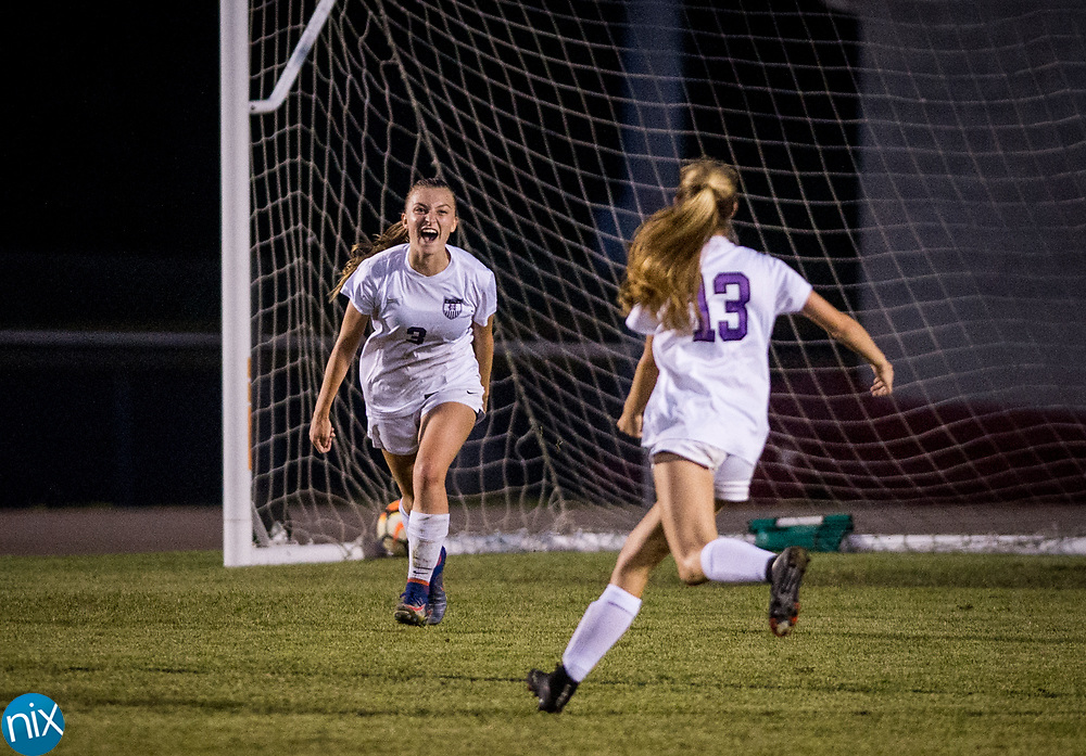 Cox Mill's Sarah McHale (3) celebrates scoring a goal in overtime to put the Chargers up 3-1 against TC Roberson during the regional finals of the NCHSAA Playoffs Tuesday, May 22, 2018. Cox Mill won 3-1 in overtime to advance to the state championship game.