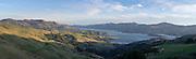 Panoramic, high-angle view overlooking Akaroa Harbor, on the Banks Peninsula, near Christchurch, New Zealand