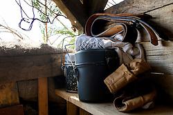 German Luftwaffe/Fallschirmjäger Mess tins gloves and belt sit on a shelf in camouflaged bunker at the Yorkshire War weekend<br />  04 July 2015<br />  Image © Paul David Drabble <br />  www.pauldaviddrabble.co.uk