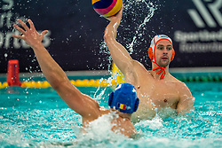 Kjeld Veenhuis of the Netherlands in action against Romania during the Olympic qualifying tournament. The Dutch water polo players are on the hunt for a starting ticket for the Olympic Games on February 16, 2021 in Rotterdam