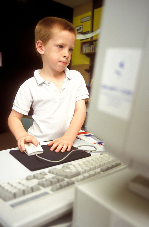 Young child using computer,