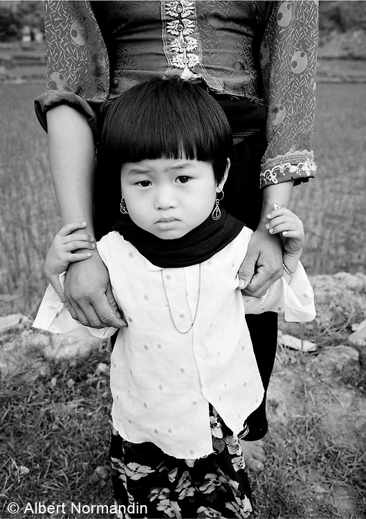 Child in traditional dress with mother