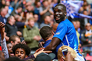 Chertsey Town's Quincy Rowe (6) jumps into the crowd at full time during the FA Vase final match between Chertsey Town and Cray Valley at Wembley Stadium, London, England on 19 May 2019.