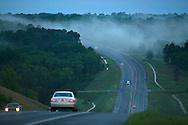 road through the hills of Arkansas on a rainy cloudy day