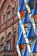 Contrasting old and new architecture in London. Detail of facades on Oxford Street, London. Left: Late 19th century facade now Radcliffe College Language School. Right: 187-195 Oxford Street faceted glass facade by architect's Future Systems, built 2008