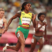 TOKYO, JAPAN August 2:    Elaine Thompson-Herah of Jamaica in action during the 200m semi finals for women during the 200m semi finals for women during the Track and Field competition at the Olympic Stadium  at the Tokyo 2020 Summer Olympic Games on August 2nd, 2021 in Tokyo, Japan. (Photo by Tim Clayton/Corbis via Getty Images)